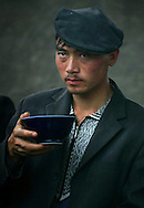 A Uygur ethnic minority man enjoys a bowl of  ìopkeî a broth made from stuffed intestines and goat bits including the head, at the famed livestock Sunday market bazaar in Kashgar, a major silk road hub for over 2000 years and the heartland of the Uygur ethnic minority in China, Sunday May 21, 2006.