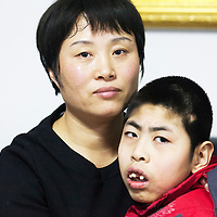 Beijing, March 11 : Tian Peng, 15, is taken care of by his mother Cui Xinying while his little brother Tian Ye, 3, plays in the apartment.<br /> As a baby Tian Peng fell ill with brain   hemorrhage supposedly due to a lack of vitamin K. When Tian Peng was a kid, friends advised the parents to simply abandon him as there's neither enough help nor support in China apart from a small NGO. Tian is unable to speak, think, walk and needs help for everything.<br /> Chinese attitudes towards people with disabilities have improved in recent years, but the support of society and opportunities in education and employment are scarce.<br /> Chinese attitudes towards people with disabilities have improved in recent years, but the support of society and opportunities in education and employment are scarce.
