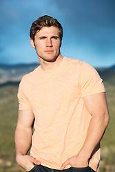 shirtless muscular man inside a cabin All American man outdoors overlooking a mountain range at sunset