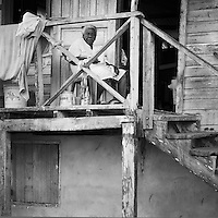 Old woman sleeping in a chair on the front porch of here home on the island of Bastimento, Bocas del Toro, Panama