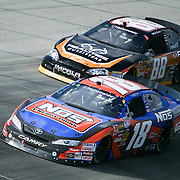 Kyle Busch #18 and Elliott Sadler #88 near turn #2 at The Nationwide Series race at Dover International Speedway in Dover Delaware. Kyle Busch wins the Nationwide Series final.