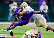 William and Mary Linebacker Michael Pigram ties to take down an airborne James Madison's Eugene Holloman as he dives over another defender en route to a first down  during second quarter action at Bridgeforth Stadium in Harrisonburg Saturday. JMU won 48-24.