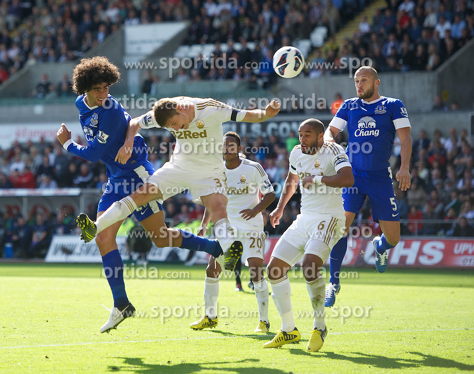 22.09.2012, Liberty Stadion, Swansea, ENG, Premier League, Swansea City vs FC Everton, 5. Runde, im Bild Everton's Marouane Fellaini in action against Swansea City's Ben Davies during the English Premier League 5th round match between Swansea City AFC and Everton FC at the Liberty Stadium, Swansea, Great Britain on 2012/09/22. EXPA Pictures © 2012, PhotoCredit: EXPA/ Propagandaphoto/ David Rawcliff..***** ATTENTION - OUT OF ENG, GBR, UK *****