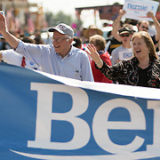 Democratic presidential hopeful Sen. Bernie Sanders (D-VT) and Jane Sanders wave Saturday, July 4, 2015, during the Independence Day Parade in Creston, Iowa.  REUTERS/Scott Morgan