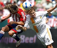 20 May 2007:#5 Chris Albright heads the ball away from #6 Fransisco Mendoza and suffers a hamstring injury on this play during a 1-1 tie for MLS Chivas USA vs. Los Angeles Galaxy pro soccer teams at the Home Depot Center in Carson, CA.