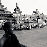 Buddhist monk in front of Botataung Paya, Yangon, Myanmar, 15th May 2013