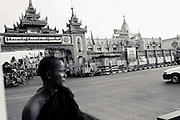 Buddhist monk in front of Botataung Paya, Yangon, Myanmar, 15th May 2013