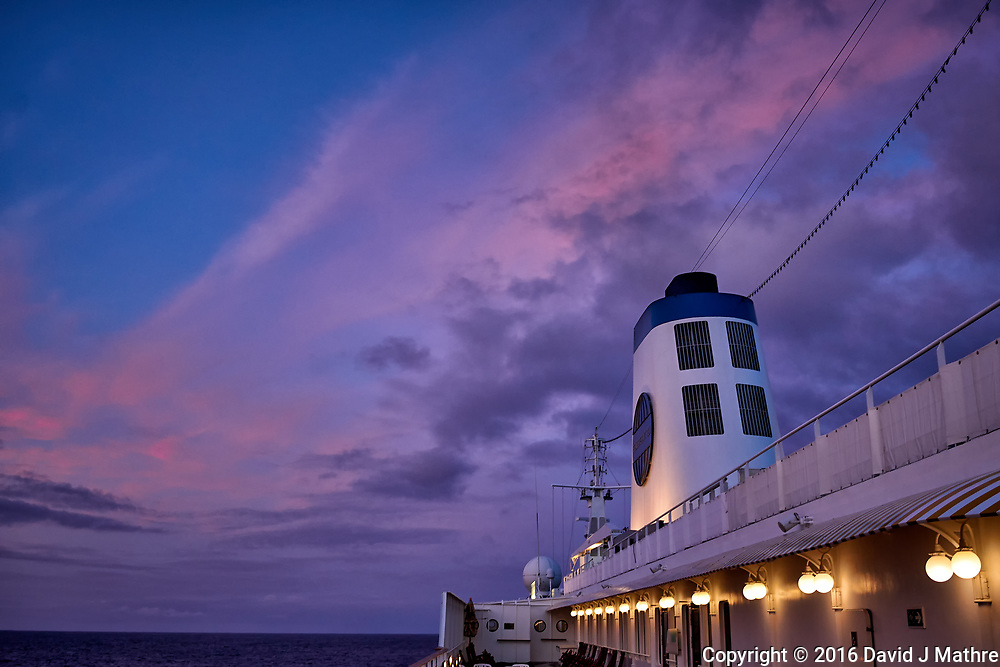 Pink clouds over the MV World Odyssey at dawn. Semester at Sea, 2016 Spring Semester Voyage. Day 3 of 102. Image taken with a Leica T camera and 23 mm f/2 lens (ISO 400, 23 mm, f/3.5, 1/30 sec).
