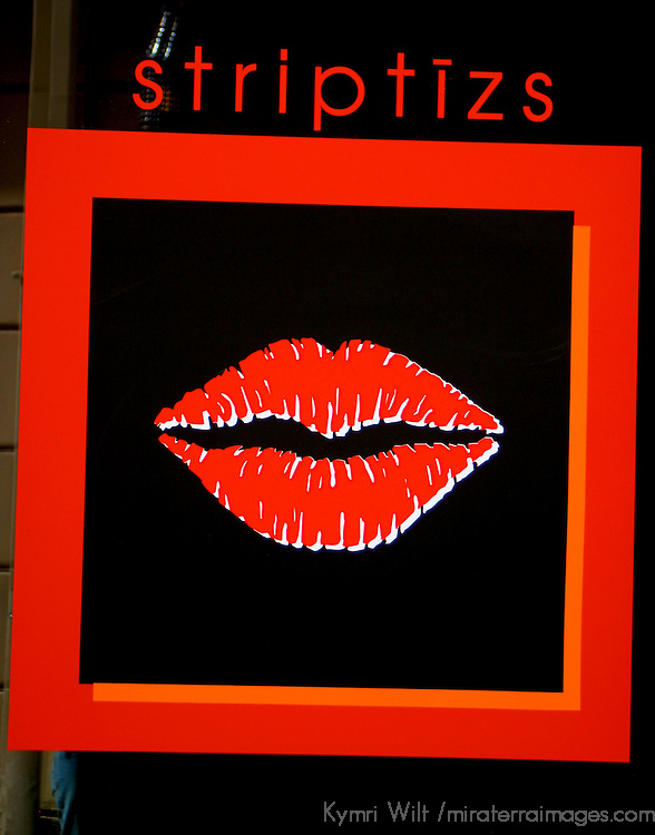 Europe, Latvia, Riga. A sign in  a Riga nightclub window advertising striptease.