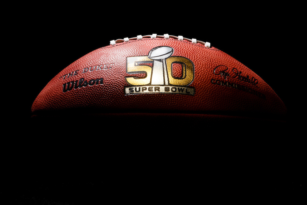 An official game ball for the NFL Super Bowl 50 football game is photographed, Tuesday, Jan. 26, 2016. The Wilson Sporting Goods football factory in Ada, Ohio has made the official Super Bowl football since the first Super Bowl in 1966. The company began making this year's game balls last Sunday night, Jan. 24, immediately after the conclusion of the NFC and AFC championship games. The Denver Broncos will play the Carolina Panthers in the Super Bowl on Feb. 7, in Santa Clara, CA. (AP Photo/Rick Osentoski)