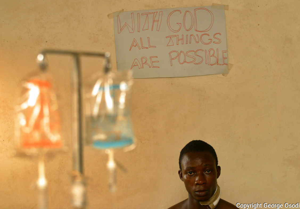 Itsekiri youth who sustained a bullet wound during a protest at Escravos one of the country's main oil export terminals on Friday, sits in a hospital bed in Warri, Nigeria, Saturday, Feb. 5, 2005. More than 200 demonstrators broke into the Escravos terminal, operated by ChevronTexaco, on Friday demanding it be shut down until more local people are hired. They also demanded ChevronTexaco fulfill other promises it made after a similar protest in 2002, such as supplying new houses, water and electricity for the Nigerian delta village of Ugborodo. ( Photo/George Osodi)