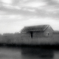 PL12120-00...North Carolina - Pinhole image of a shed on Bald Head Island.