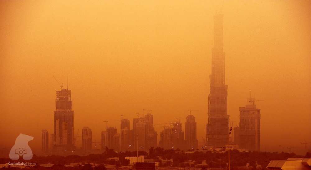 Burj Khalifa - the tallest man-made structure in the world - and other buildings in its vicinity are shrouded by a thick sandstorm, Dubai, United Arab Emirates.