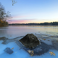 Lake Cochituate borders the Boston suburbs Natick, Wayland and Framingham and is part of the Cochituate State Park in Massachusetts. This peaceful New England winter photography image was captured on a quiet morning in January. The early morning light painted the New England scenery in beautiful colors and hues. A mixture of blue sky and the fading sunrise light and colors and the bolder surrounded by fallen memories of autumn provided perfect background and foreground elements for this Massachusetts nature photography image. I love experience the quietude that comes with an early morning photo shoot. <br /> <br /> Lake Cochituate winter photos are available as museum quality photography prints, canvas prints, acrylic prints or metal prints. Prints may be framed and matted to the individual liking and room decor needs:<br /> <br /> http://juergen-roth.pixels.com/featured/new-england-winter-juergen-roth.html<br /> <br /> Good light and happy photo making! <br /> <br /> My best, <br /> <br /> Juergen <br /> Image Licensing: http://www.RothGalleries.com <br /> Fine Art Prints: http://fineartamerica.com/profiles/juergen-roth.html <br /> Photo Blog: http://whereintheworldisjuergen.blogspot.com <br /> Twitter: https://twitter.com/naturefineart <br /> Facebook: https://www.facebook.com/naturefineart <br /> Instagram: https://www.instagram.com/rothgalleries