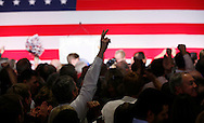 Republican supporters cheer as a giant TV screen displays the results of the U.S. Senate race in the U.S. midterm elections in Denver, Colorado, November 4, 2014.  REUTERS/Rick Wilking (UNITED STATES)