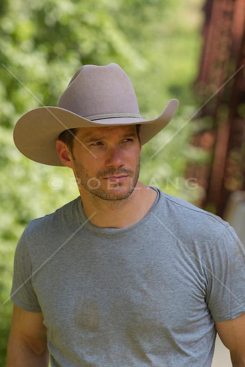 good looking rugged cowboy outdoors