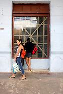 Window shopping in Moron, Ciego de Avila, Cuba.