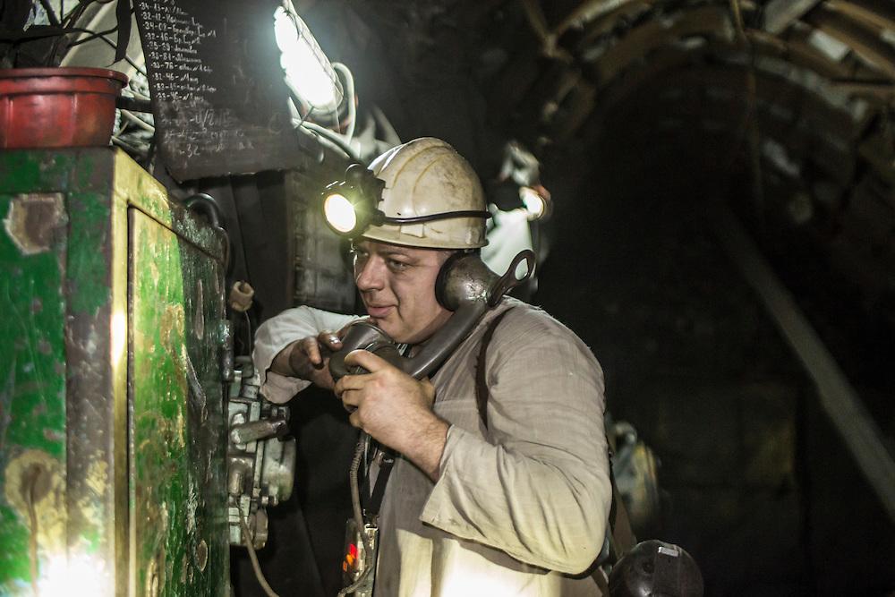 A miner talks on a phone 1000 meters underground inside the Shcheglovskaya Coal Mine on Friday, March 25, 2016 in Makiivka, Ukraine.