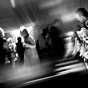 A couple shows off some fancy moves on the dance floor at a reception in South Lake Tahoe, Nevada.