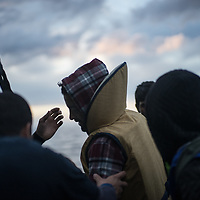 A migrant is been helped to land on the north shores of Lesvos after crossing the Aegean sea from Turkey. FEDERICO SCOPPA/CAPTA
