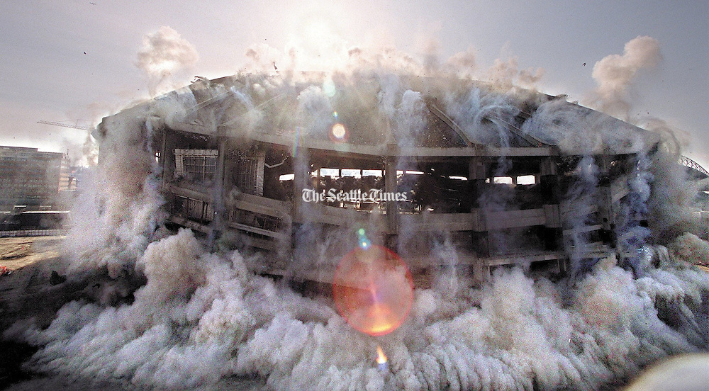The Kingdome begins to collapse on itself moments after charges were detonated on March 26, 2000.<br /> Greg Gilbert / The Seattle Times