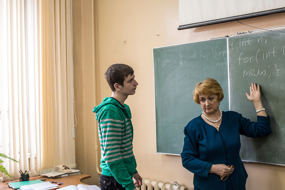 Computer science teacher Larisa Ishkova works with students at Kanyayev College on Tuesday, February 25, 2014 in Tver, Russia. Ishkova taught Alexander Panin, a Russian citizen who was arrested in the Dominican Republic in June 2013, and is set to be charged by federal authorities in the US with being part of a gang which robbed bank accounts via the Internet. Photo by Brendan Hoffman, Freelance