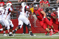 Sept 8, 2012; Piscataway, NJ, USA; Rutgers Scarlet Knights defensive tackle Scott Vallone (94) rushes the passer during the first half at High Point Solutions Stadium.