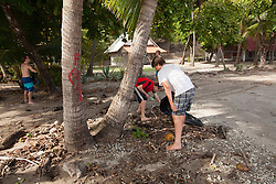 2012 August 05:  Cleaning the beach in Playa Sámara, Costa Rica.