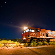 The Ghan.  Night skies over the Ghan near Tennant Creek.  A scheduled stop at 1am to allow a freight train to pass. Northern Territory, Australia. Image © Arsineh Houspian/Falcon Photo Agency.