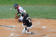 Mississippi catcher Taylor Hightower blocks the ball as Louisville's Ryan Wright scores at Oxford-University Stadium in Oxford, Miss. on Sunday, March 14, 2010. Louisville won 10-8.