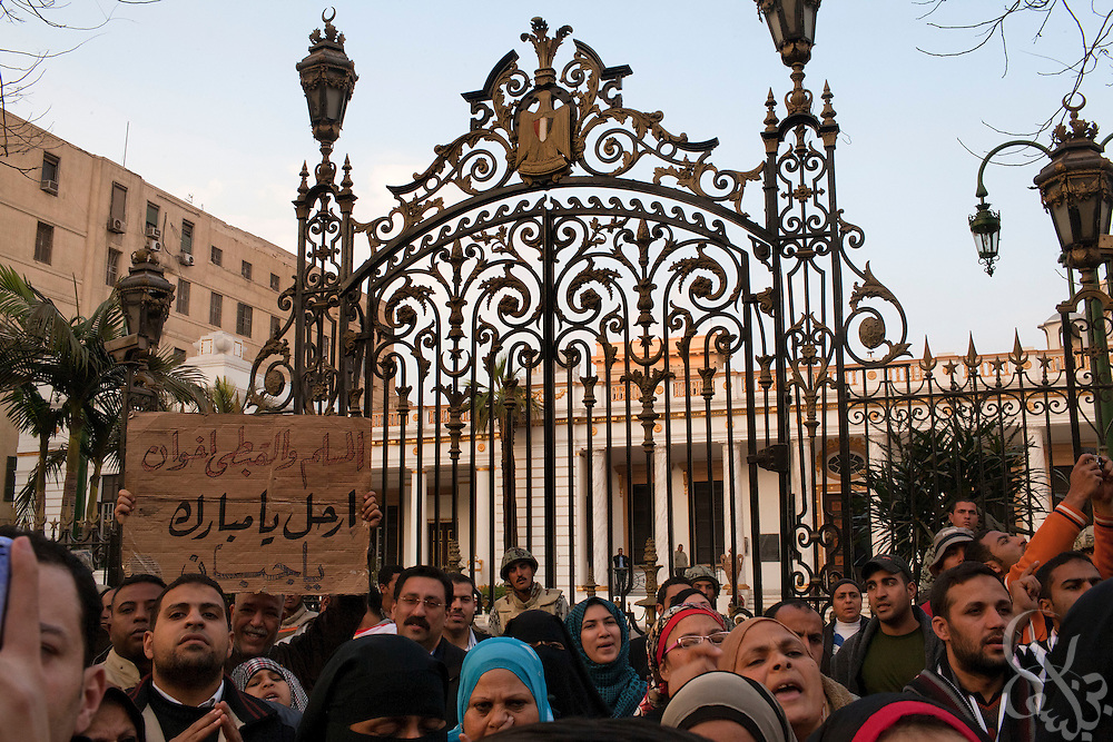 A group of more than 1000 Egyptian protesters chants anti-government slogans outside the gates of the Parliament building February 08, 2011 in Cairo, Egypt. The numbers of protesters in and around Tahrir swelled again today after a few days where it seemed momentum had been lost and the crowds were thinning. .Slug: Egypt.(Photo by Scott Nelson)