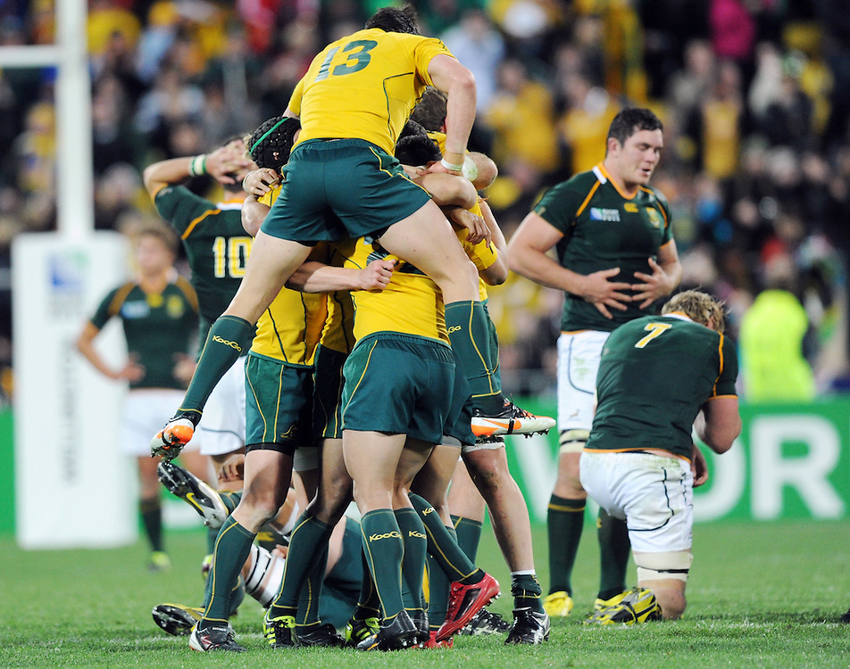Australia's Adam Ashley-Cooper leaps on his team mates after their win over South Africa in the Rugby World Cup quarter final match at Wellington Stadium, Wellington, New Zealand, Sunday, October 09, 2011. Credit:SNPA / Ross Setford