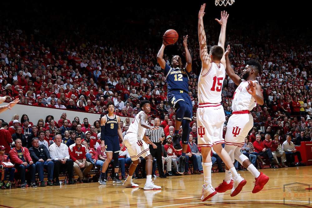 Michigan guard Muhammad-Ali Abdur-Rahkman (12) in action as Michigan played Indiana in an NCCA college basketball game in Bloomington, Ind., Sunday, Feb. 12, 2017. (AJ Mast)