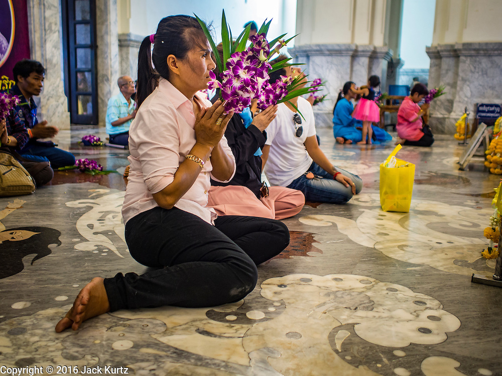 14 JANUARY 2016 - CHACHOENGSAO, CHACHOENGSAO, THAILAND: People pray in the chapel at Wat Sothon. Wat Sothon, in Chachoengsao, is one of the largest Buddhist temples in Thailand. Thousands of people come to the temple every day to pray for good luck, they make merit by donating cooked eggs and cash to the temple. The temple dates from the Ayutthaya period (circa 18th century CE).         PHOTO BY JACK KURTZ