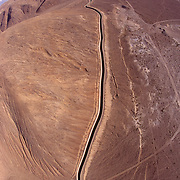 aerial view of the Los Angeles Aqueduct as it winds through the desert below the Eastern Sierras near Lone Pine California.
