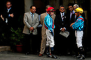 Jockeys and owners just before a race. Champ de Mars Racecourse. Port Louis. <br />