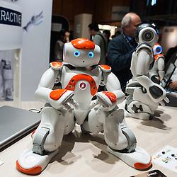 Lyon, France - 19 March 2014: NAO Robot by Aldebaran at Innorobo 2014, the 4th international trade show on service robotics.