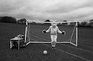 A parent dressed in a Bunny suit guards the goal post during the Easter School Fair in Berkhamsted  Saturday, March 28, 2015 (Elizabeth Dalziel)  Children and mothers inhabit a strange place that until a few years ago I didn't know existed. Even as I child I was oblivious to it. Now my days are spent with costumed Storm Troopers patrolling my hallways. My evenings are filled with dinners and bath times and bedtime reading and tantrums and so much else. This is my new normal, and taking pictures makes me stop and look. This project has let me see photographs where before I thought there were none. It has allowed me to see the universality of my life and how it is reflected in so many other lives.#thesecretlifeofmothers #bringinguptheboys