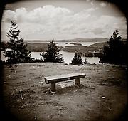 PL10310-00...WASHINGTON - Holga image of a bench on Orcas Island part of the San Juan Islands Group.