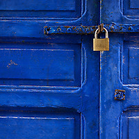 A golden lock rests on a blue door in the Atlantic coastal town of Essaouria on the northern Moroccan coast.