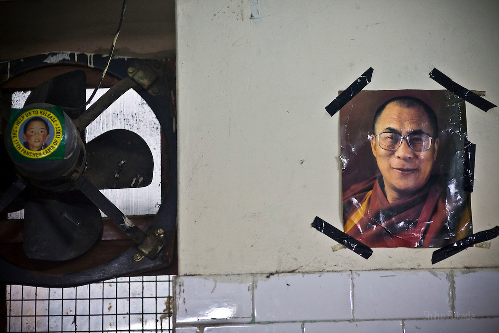 INDIA - Life in Exile (Tibetan Refugees) <br /> A picture of Dalai Lama, right, and &quot;Free Panchen Lama&quot; campaign sticker are seen at reception center, a temporary shelter for newly arrived Tibetan refugees in McLeod Ganj, Dharamsala, India, where the Dalai Lama settled after fleeing Tibet in 1959 after a failed uprising against Chinese rule, May 29, 2009.  The 11th incarnation of the Panchen Lama, Gedhun Choekyi Nyima, was taken custody by Chinese authorities and vanished from public eyes shortly after being named by Dalai Lama in 1995.