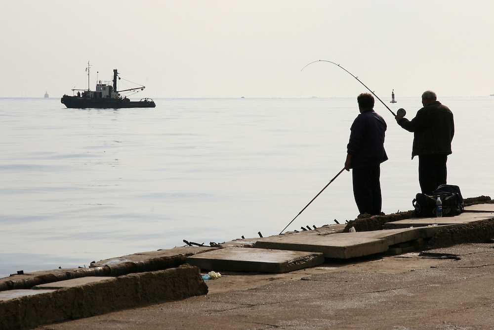 Men fish in the Caspian Sea on October 30, 2005 in Baku, Azerbaijan.