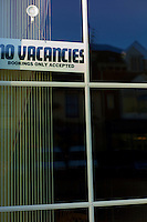 Signs in B&B windows in Blackpool, Lancashire indicating if they have any vacant rooms to let.