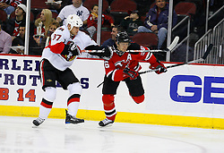 Jan 4, 2008; Newark, NJ, USA; Ottawa Senators center Dean McAmmond (37) hooks New Jersey Devils left wing Patrik Elias (26) around the neck during the second period at the Prudential Center.