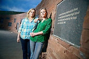 SHOT 4/18/14 7:11:03 PM - Former Columbine High School students Jennifer Hammer (left), 33, of Commerce City, Co. and Heather Egeland, 32, of Littleton, Co. pose for a portrait at the Columbine Memorial recently. The two are co-founders of The Rebels Project, a support group that has helped survivors of other mass shootings around the country, from Virginia Tech to Chardon, Ohio to Newtown, Conn. On the day of the Columbine shootings in 1999 the two were huddled in the choir office with about 60 other students hiding from the shooters. (Photo by Marc Piscotty / © 2014)