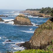 The Pacific Ocean cuts sea stacks from rocky coast at Mendocino, California, USA.