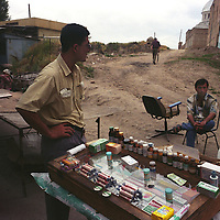 Stall holder selling medicines and pharmaceuticals in the Chorsu bazaar market, in Tashkent, one of the cities on the old Silk Road trading route. Uzbekistan.