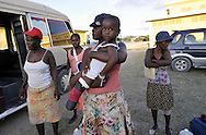 FOND PARISIEN, HAITI.  A Haitian woman arrives with her daughter with an amputated lower left leg at the Love a Child Health Center in Fond Parisien, Haiti on Thursday, January 28, 2010. The campus has been transformed from a small field clinic to a camp for Internally Displaced Persons (IDP) after the massive 7.0 earthquake that struck the island on January 12th., killing upwards of 200,000 people.