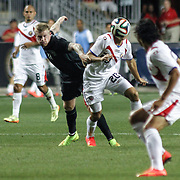 Costa Rica Midfielders Diego Calvo (20) dribbles the ball up field as Republic of Ireland Midfielders James McClean (11) defends in the second half of the inaugural freedom cup between Ireland and Costa Rica Friday. June. 6, 2014 at PPL Park in Chester PA.