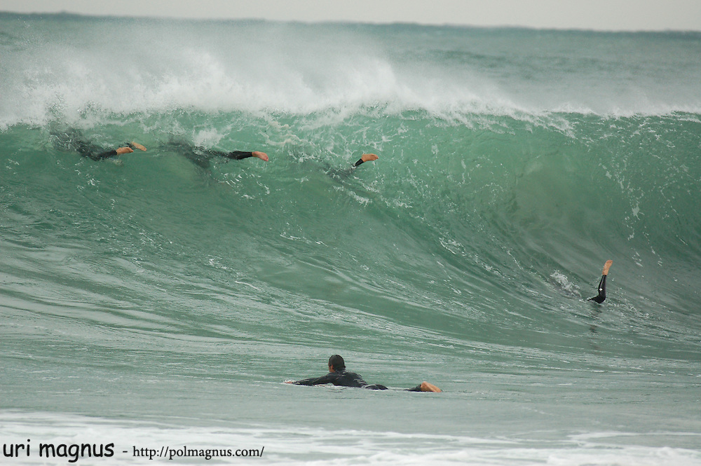 this photo win google photography prize , top 100.<br /> this photo show the duck dive of the surfer under the wave.
